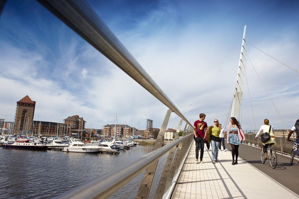 Students on Sail Bridge. Source: Swansea University