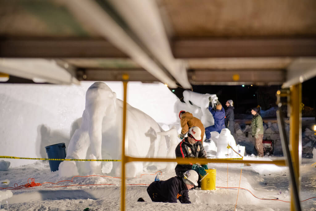 students at Michigan Tech working on sculptures during the Winter Carnival All-Nighter